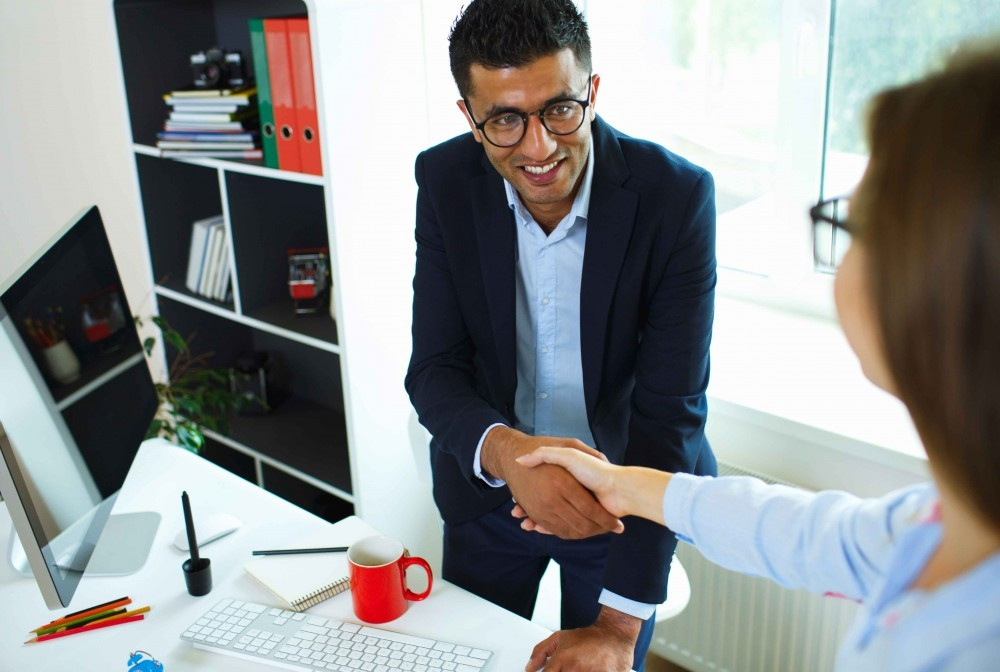 male business man shaking hands with a woman