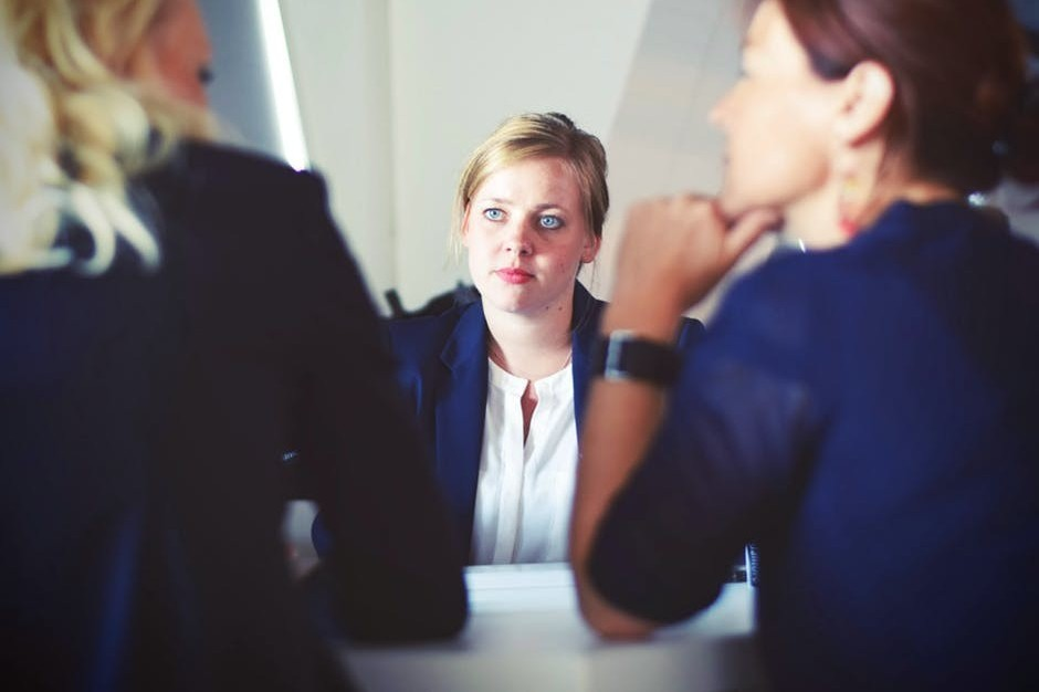 Woman experiencing difficulty during job interview